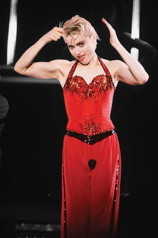 Madonna in 1990 wearing a sweetheart jumpsuit. It's a revolutionary look!
