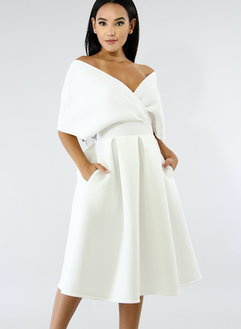 This is an image of a white midi dress that illustrates a portrait neckline as a main design element.