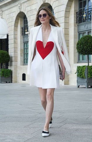 What a beautiful example of a plunging neck style in a dress, stunning heart design element in red in front of a beautiful white mini dress. Divine!