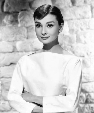 Audrey Hepburn is depicted in her iconic boatneck white dress, that she made super populate in 1950, especially after her main role in Sabrina.