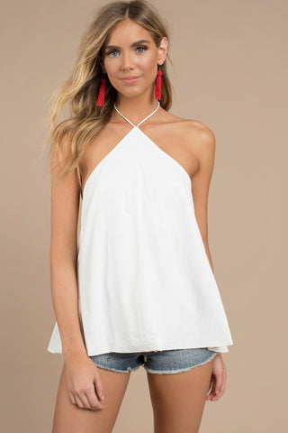 This is an image of a white summer halter top, triangle shape, closing behind your neck, hip length.