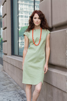 Jessie is wearing  our one of a kind Drop Shoulder Sheath dress  with Scallop Hem. It's unique design features and custom Sage Green color will assure you look great whether at home or on your way to  grocery shopping this summer! What other plans do you have?