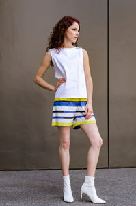 Jessie is modeling our Summer Beach Shorts made out of Italian light weight poplin in Blue and Yellow Stripes. Let the stripes spark your summer, strike a pose!