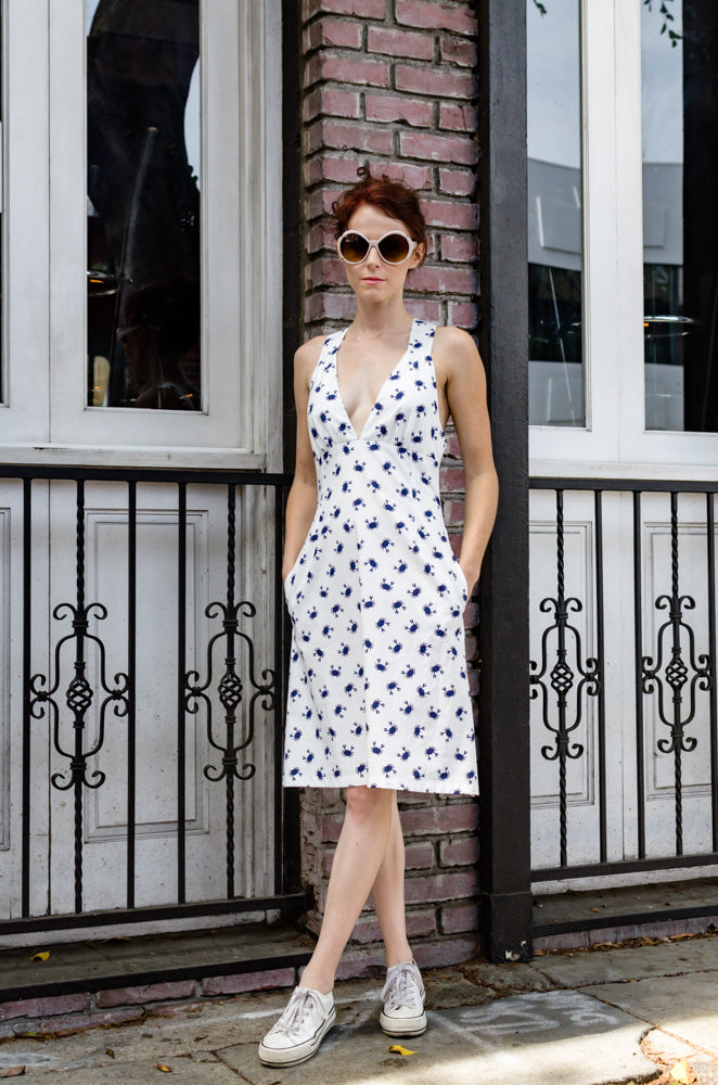 Our model, Jessie is wearing this Vintage inspired piece - wide shoulder strap dress in adorable Blue Crab print. Ruched bra like shaped top, high waisted, A-shape, knee length dress with side seam pockets definitely assure comfort and chic for you this summer. And those straps crossing in a back are complement worthy for sure!  Cheers to summer!