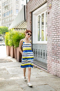 Our model, Jessie, is wearing our 50-s inspired  Square Neckline dress in Blue and Yellow Stripe. Princess lines are extending into box pleats. Open back, shoulder straps and pockets are simply chic!