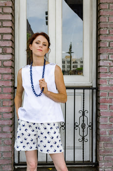 Our model, Jessie, is wearing our beloved Beach Shorts in Blue Crab. This nautical motif is just right for the occasion. Flare bottoms is a new take on a classic summer staple. Or wear a blazer and dress them up for work. Only one size left. Check them out now!