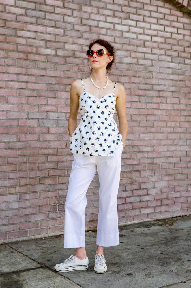 Front view of our Ankle Wide Hem Pants in White paired with our Wrap Empire Tank Top in Navy Crab. Cute, isn't it?  Just a perfect outfit to get lazy, put your hands in those pockets, like you don't care. Isn't it what the summer is about?