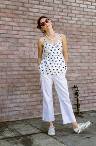 Jessie is modeling our Summer Straight Leg Boat Ankle Pants with adorable Wide Hem in White. Made out of 100% Cotton light weight Redford this pair will become your summer essential in no time. Easy Care - wear, wash, dry, repeat! No band waist yoke and front pockets are the key, and there is actually the tab to hook your keys to, as well. Going to a boat ride soon?