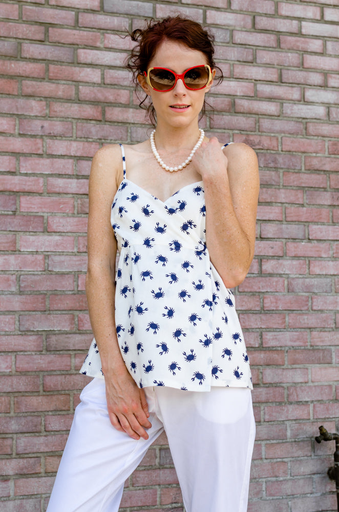 Our beautiful model, Jessie, is pairing Ankle Wide Hem Pants with Wrap Empire Tank Top in Crab print from our summer collection. What a styling combination. And put that pearls on!