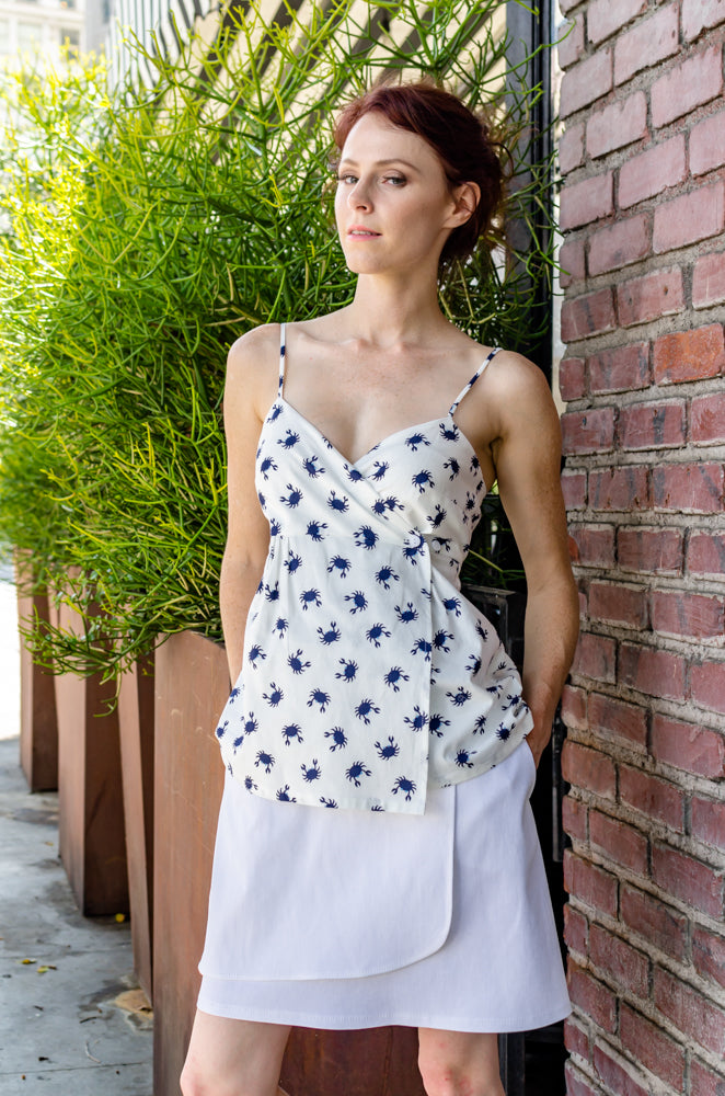 Our model, Jessie, is modeling a Wrap Mini Skirt in White and Wrap Empire Tank Top in Navy Crab from our latest Spring Summer collection. Both pieces are asymmetrical and paired well.