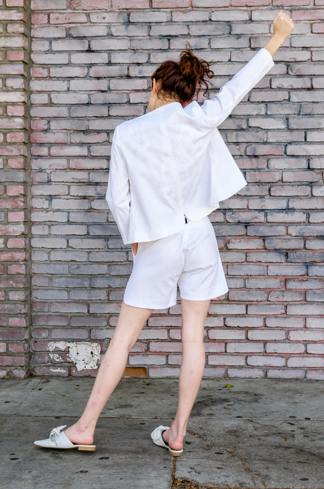Back view  of our unique Overlapping Front Jacket paid with matching Scallop Hem Shorts. Have you seen that cute back seam shaped detail?