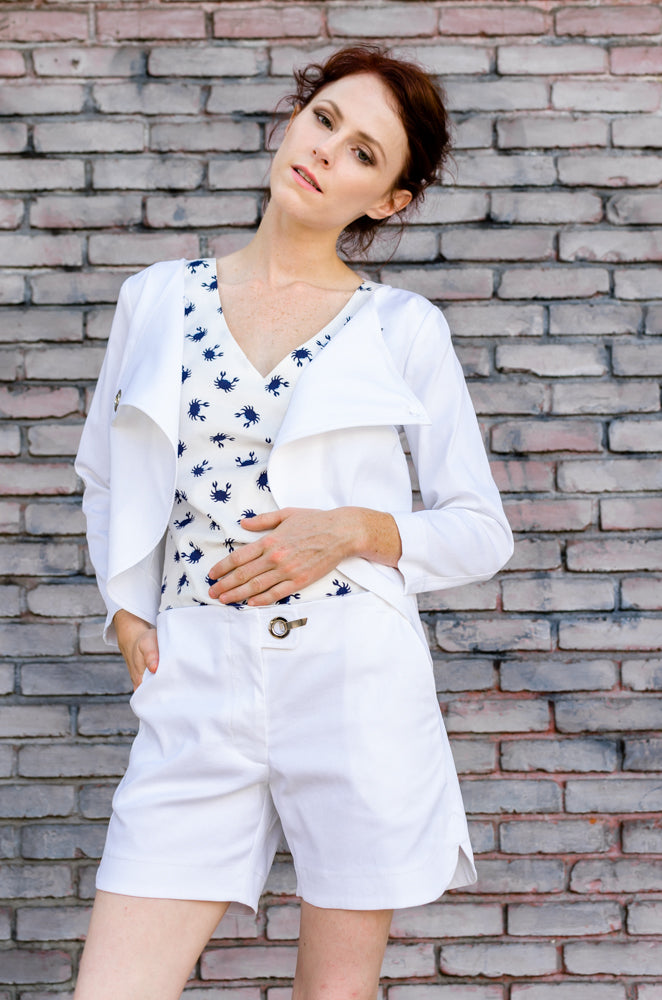 It's a perfect combo! Try our Overlapping Front Jacket in White with matching Scallop Hem Shorts paired with Boxy Top with Tie in Blue Crab! Style easy in other words! Right?