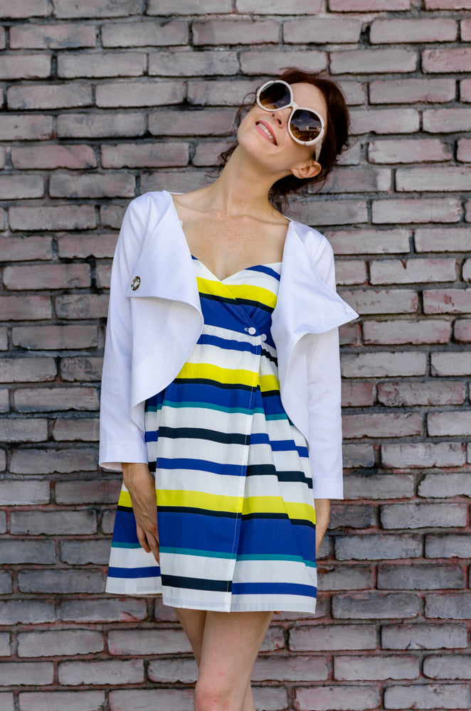 Jessie is modeling Wrap Empire Mini Dress in Yellow Stripe and Overlapping Front Cotton Cropped Jacket in White from our summer collection. The mood is - I feel good and can't help it, but smiles!