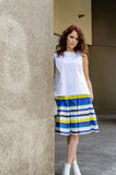 Our model, Jessie, is wearing a Box Pleat Italian Cotton Poplin Skirt with side seam pockets in Blue and Yellow Stripes combined with our A-line Cropped Top in White Pique and white ankle boots by A New Day from our designer's personal collection. Hello, summer!