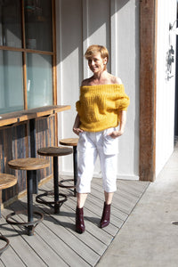 Fashion designer, Inga Goodman, is wearing her favorite, Loose Pocket Cropped Pants from her latest Spring Summer collection combined with off shoulder mustard yellow color sweater by Love Culture and eggplants ankle boots by Forever 21 from her personal wardrobe collection.