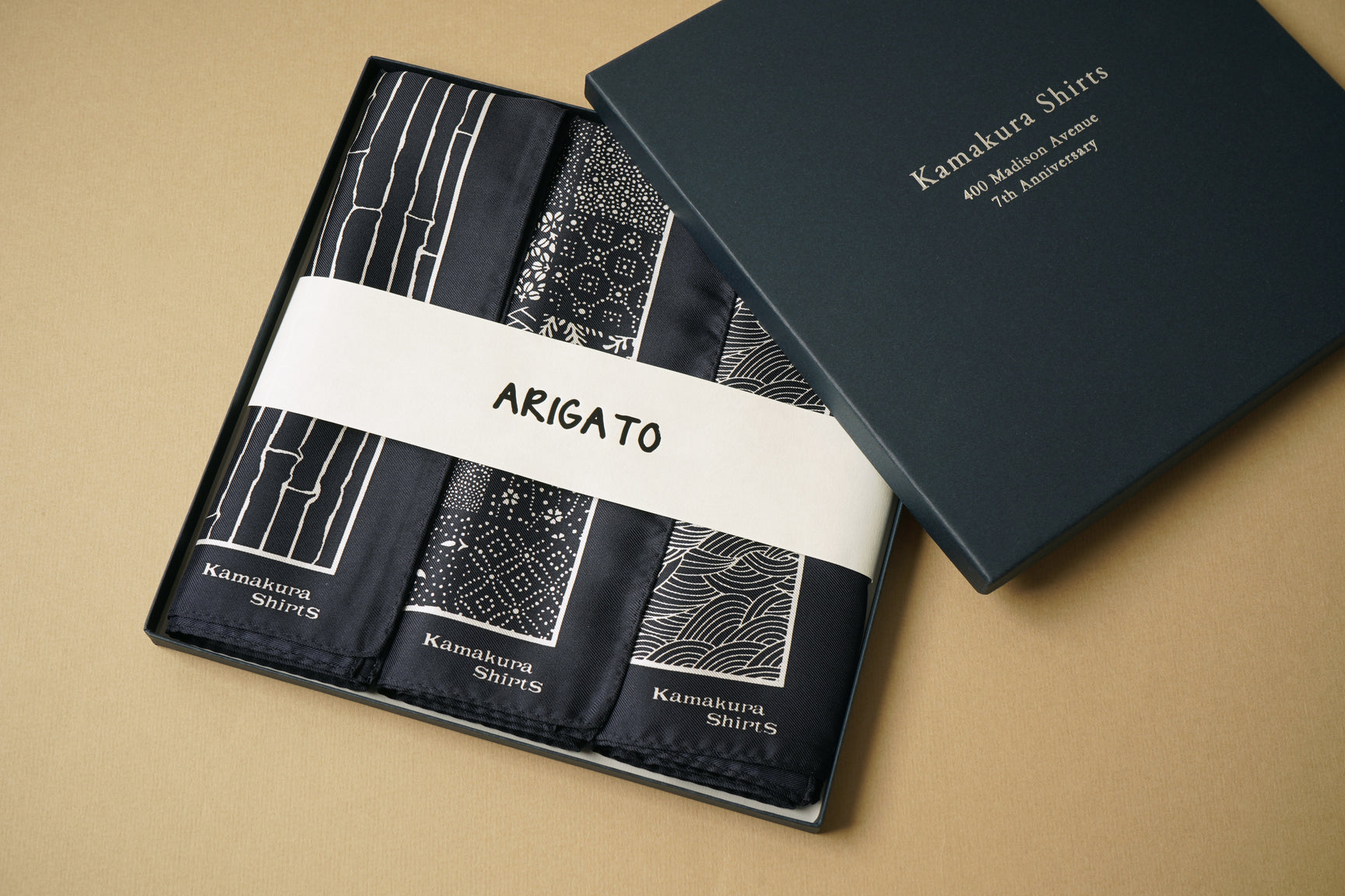 Box of pocket squares in traditional Japanese prints with a band reading 'ARIGATO'