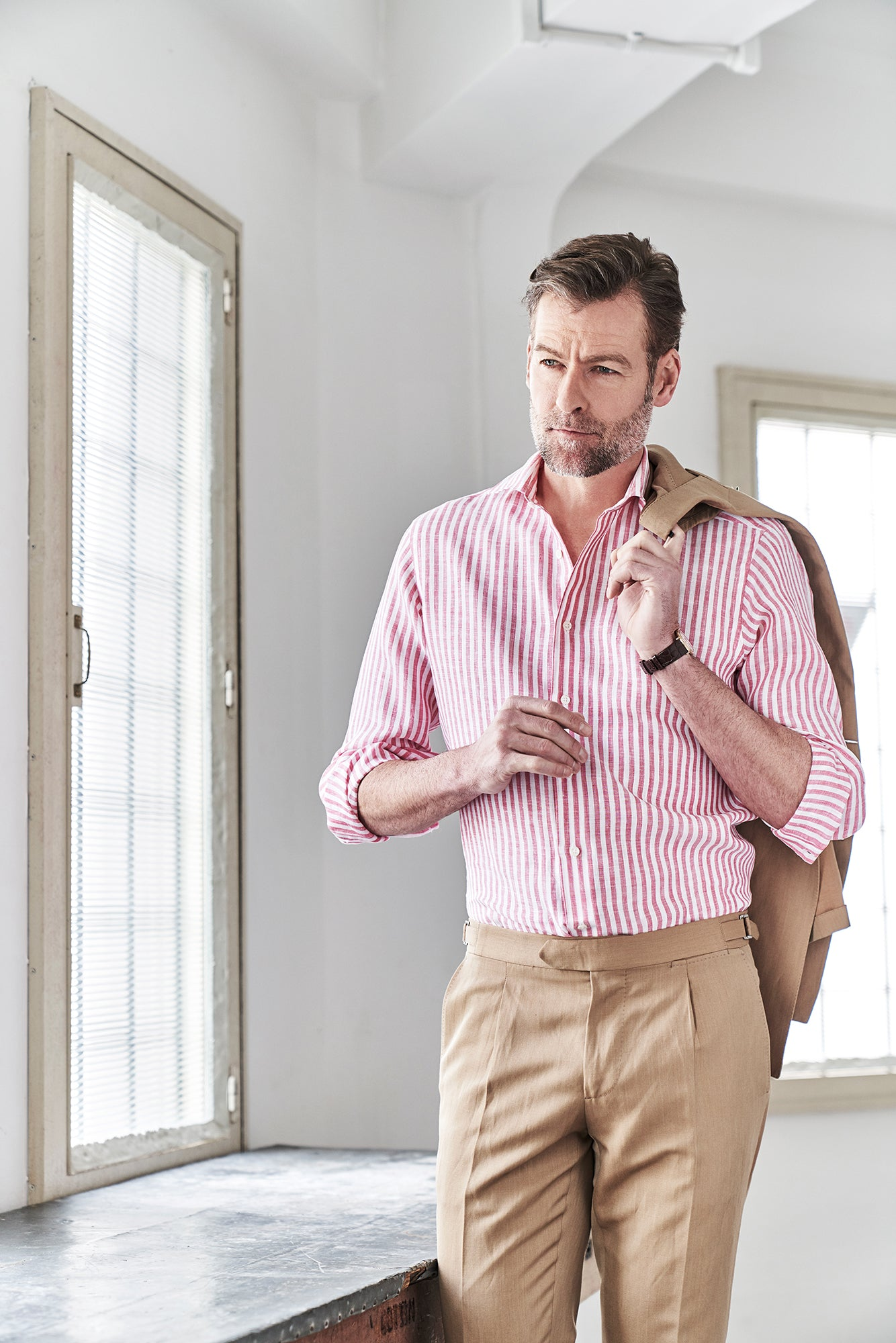 Man wearing a red and white linen shirt with khakis