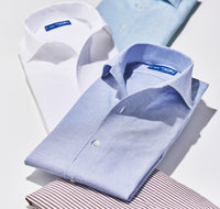 Colorful folded dress shirts