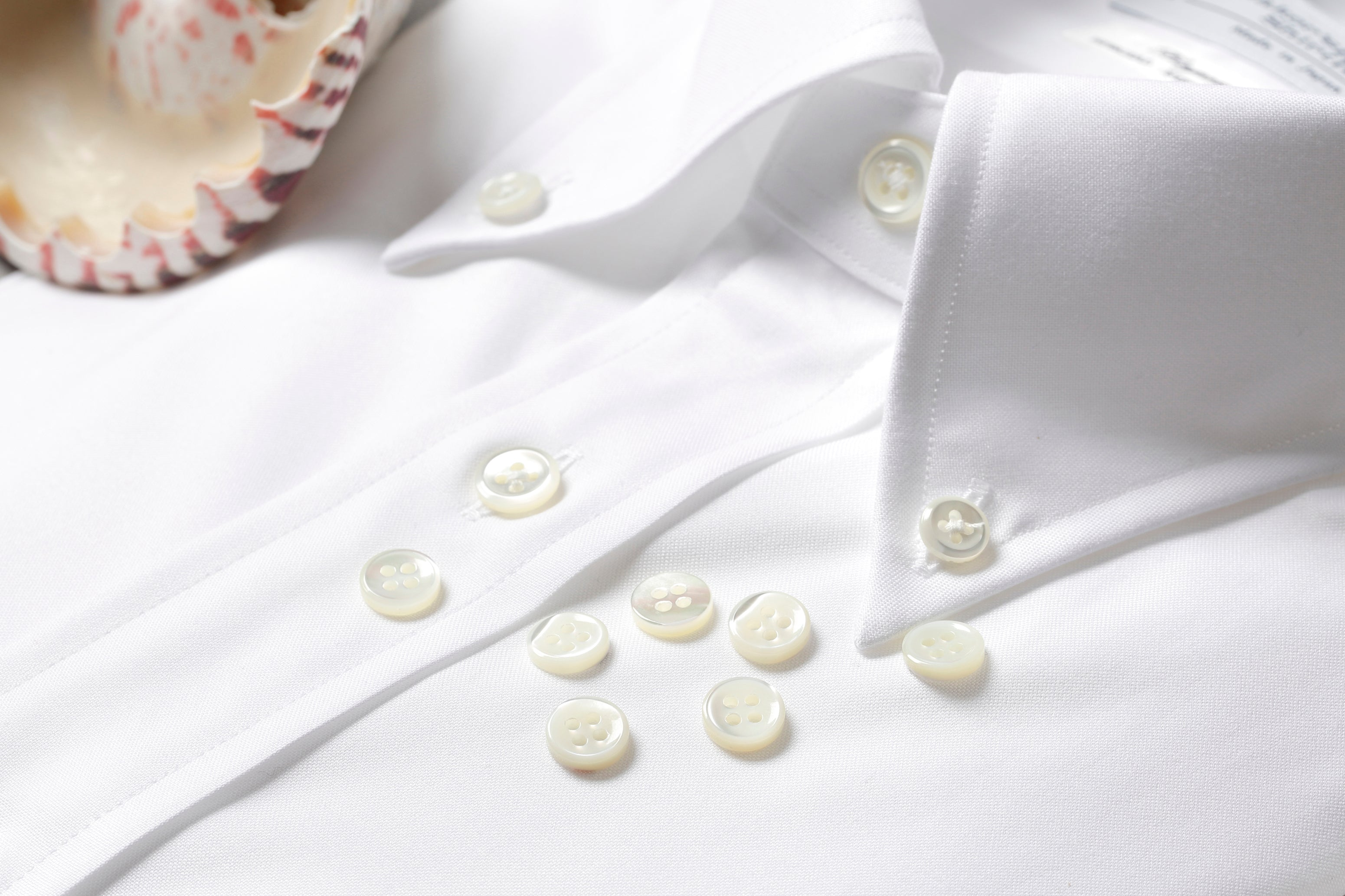 Button down shirt with various buttons