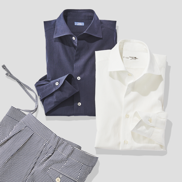 Navy and white dress shirts next to seersucker trousers