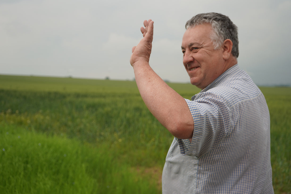 French man waving in field