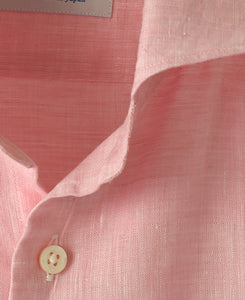 Close up of pink lintn shirt