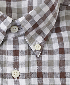 Close up of brown check linen shirt