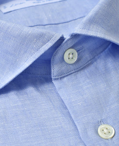 Close up of blue linen shirt