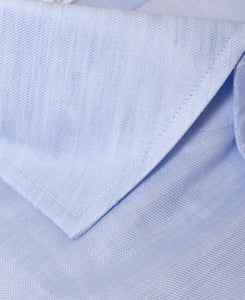 Close up of blue cotton and linen shirt