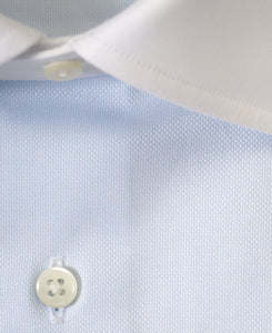 Close up of white contrast collar blue cotton shirt