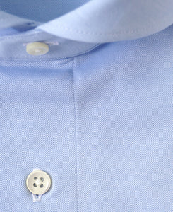 Close up of blue cotton and polyester shirt