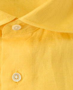 Close up of yellow linen shirt