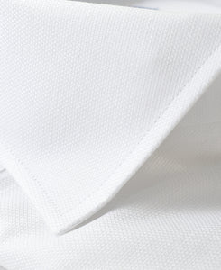 Close up of white cotton and linen shirt