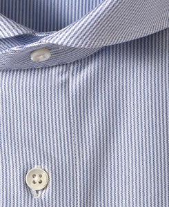 Close up of blue stripe cotton and polyester shirt