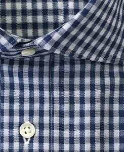 Close up of navy check cotton and polyester shirt