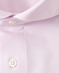 Close up of pink cotton and polyester shirt