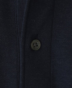 Colse up of navy cotton and polyester polo shirt
