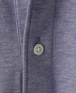 Close up of purple cotton and polyester polo shirt
