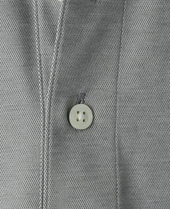 Close up of gray cotton and polyester polo shirt