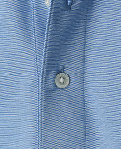 Close up of blue cotton polyester polo shirt