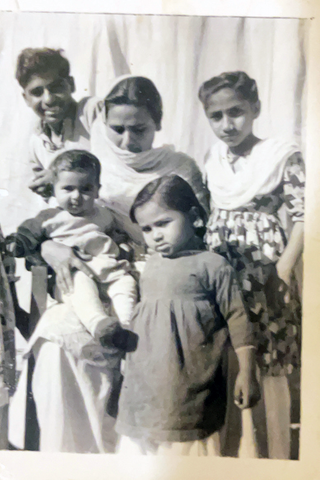 Dr. Ali Syed with his Mother & Younger Sisters