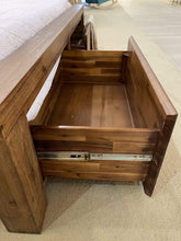 Storage drawers at foot of timber bed frame