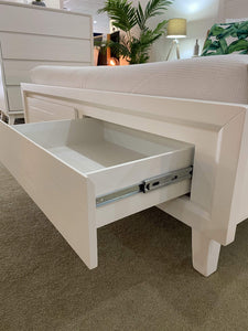Storage drawers at foot of queen bed frame
