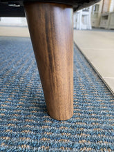 close up of wooden leg on 100% Leather Sofa Pair