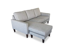 left hand facing Fabric Reversible Chaise Lounge on side camera shot
