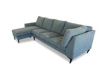 left hand facing Luxe Fabric Modular Chaise Lounge on side camera angle