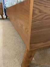close up on timber legs on bed frame