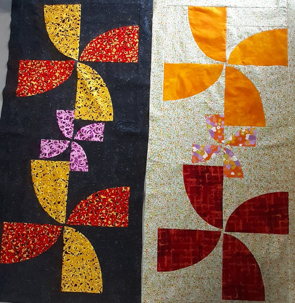 Curved piecing, windmill shape, Black background, Red, Yellow & Pink Petals