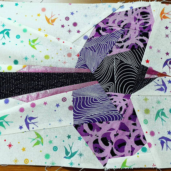 Bird in flight paper pieced with a collection of aboriginal fabrics