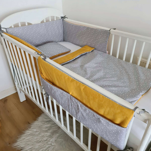 baby cot bedding set for a new baby in mustard and grey